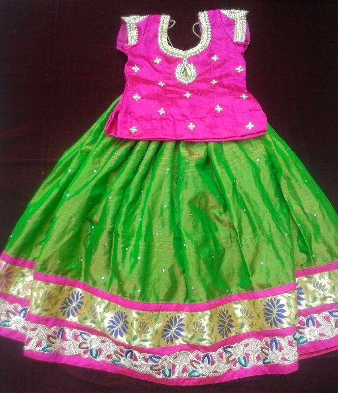 Green Pattulanga With Contrast Pink Color Blouse