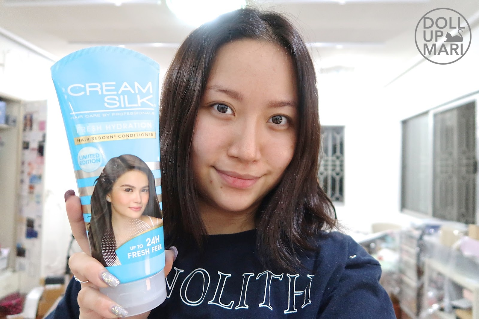 Mari Perez posed with Cream Silk Fresh Hydration Conditioner 340mL tube