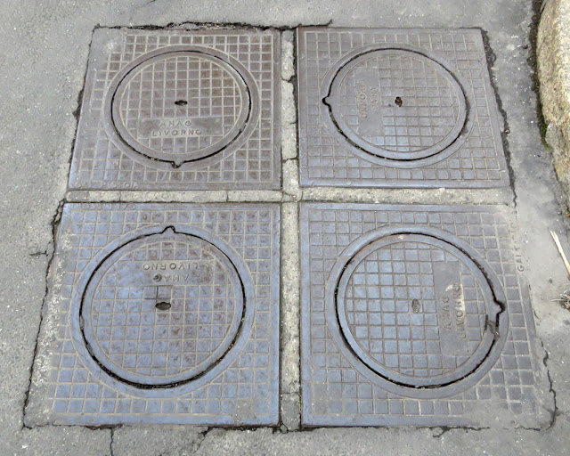 Four clearly coded manhole covers,