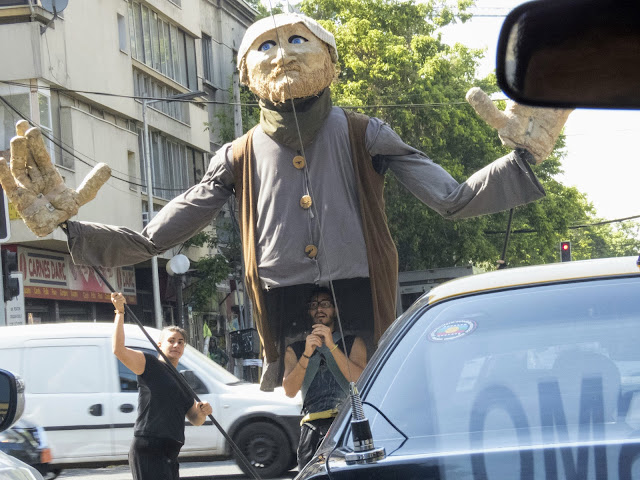 Why visit Santiago: Buskers with a giant puppet performing at an intersection