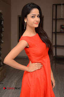 Telugu Actress Divya Nandini Stills in Orange Sleeveless Gown at Chennai Chaitrama Movie le Launch Event  0022.JPG