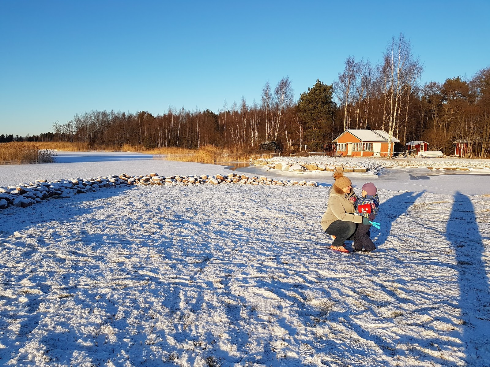 mother and daughter playing in snow in Finland