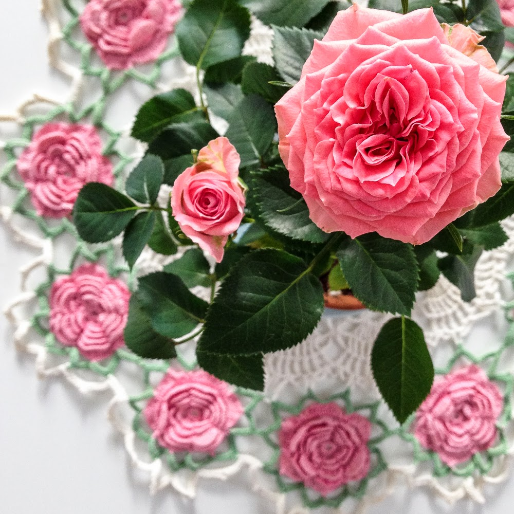 pink roses on a pink doily