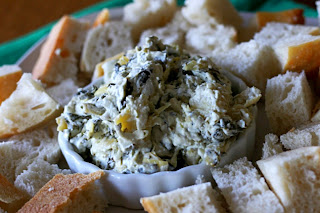 spinach dip with cubes of bread around it