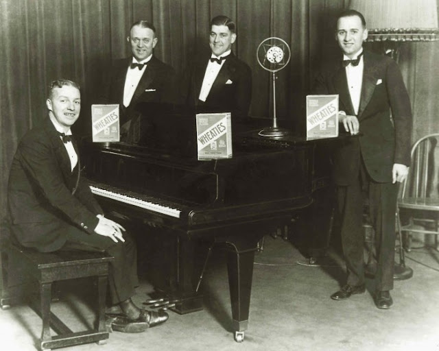 Photo c. 1930s Wheaties quartet pose by a piano.  Jingles and other stories of The American Dream. marchmaton.com
