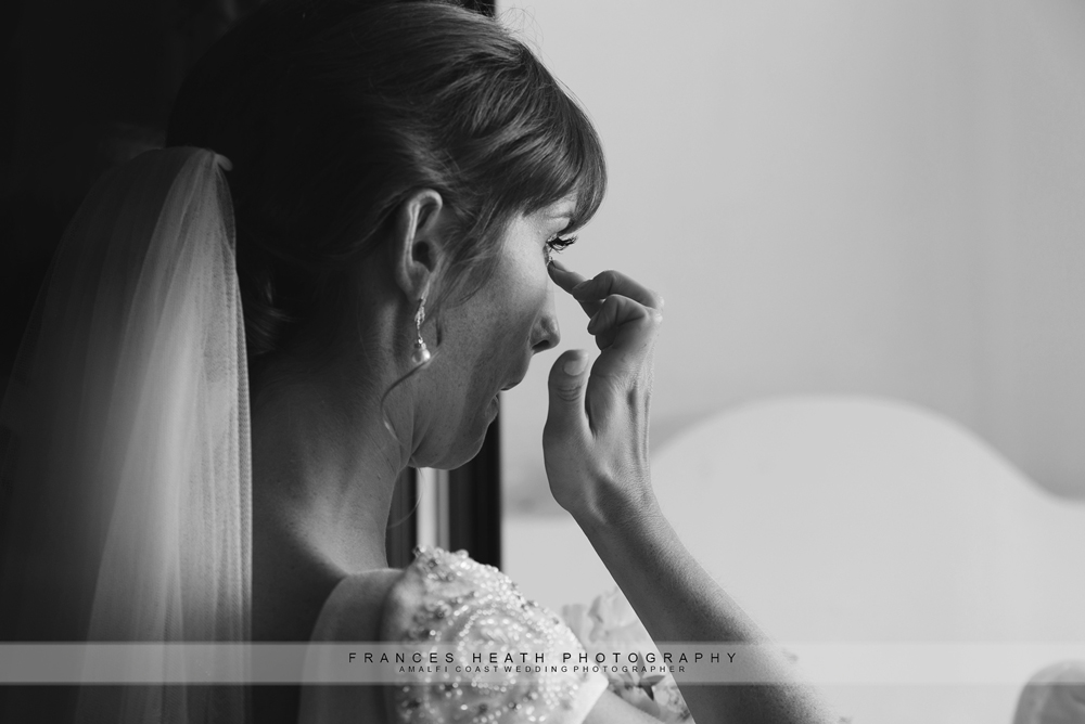 Bride sheds a tear before wedding