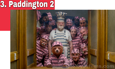 Paddington 2 2018 movie still Brendan Gleeson Ben Whishaw pink shirts in prison