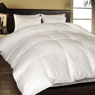 A large white freshly cleaned down comforter
