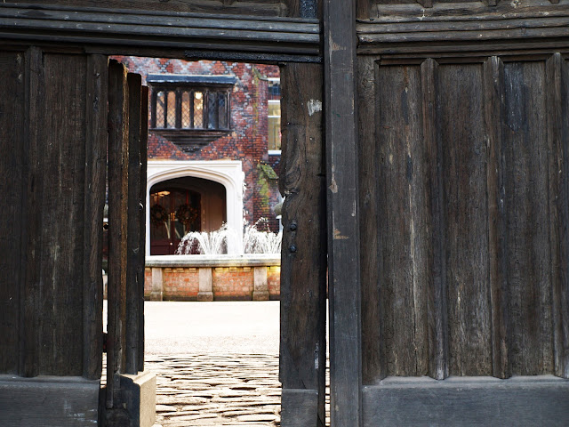 a peek through the heavy wooden front gates of fulham palace