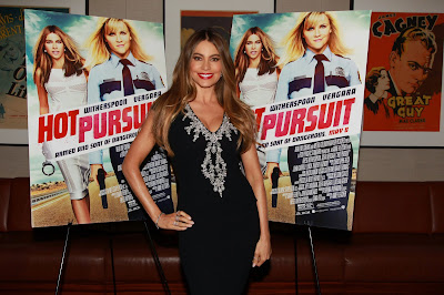 Sofia Vergara in front of Hot Pursuit Theatrical Movie Poster