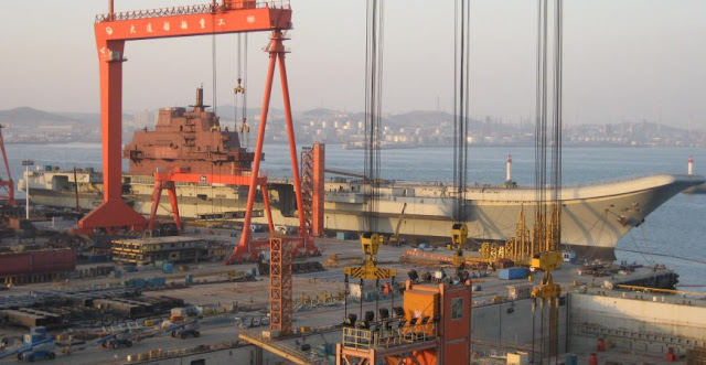 The Varyag under refit at the Dalian Shipyard