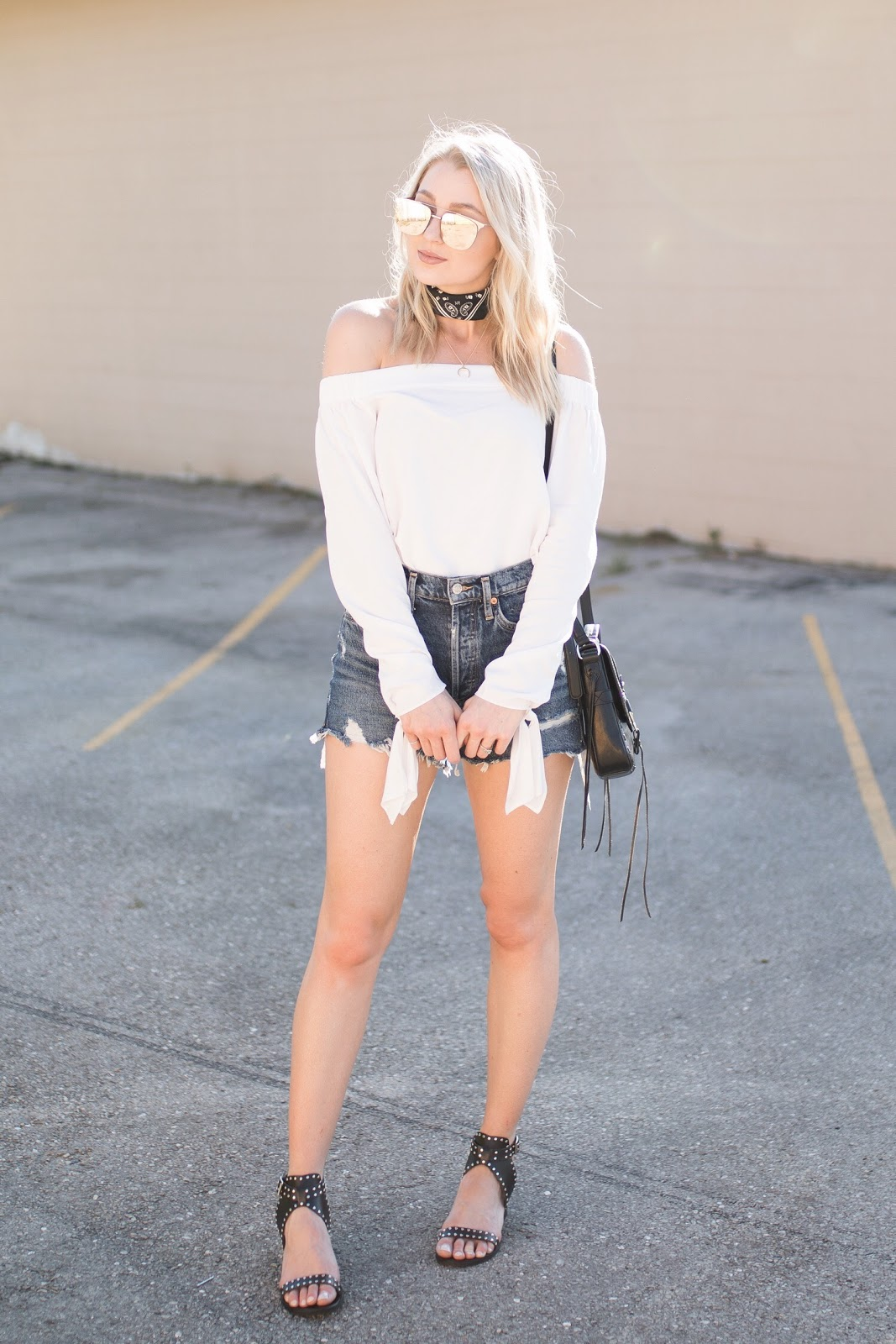 white off-the-shoulder top + cutoff denim shorts