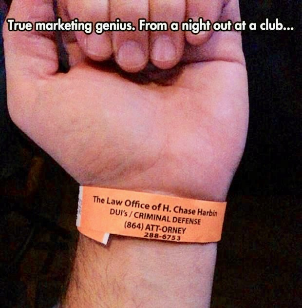 True Marketing Genius. Photo of an entrance wrist band from a night club, advertising a local criminal defense attorney. Court Humor. Judgmental. marchmatron.com