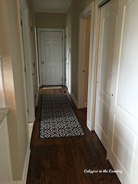 Hallway with new runner with a patterned tile look