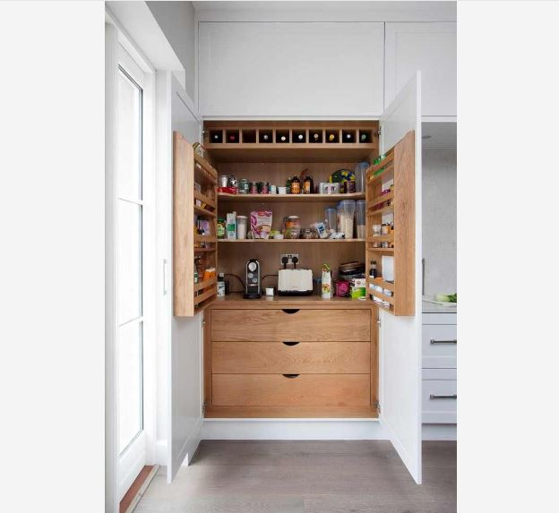 Hidden kitchen cabinets with storage options