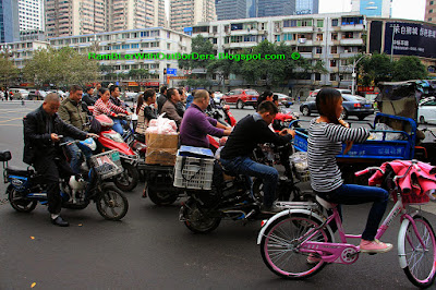 Motorcycles and bicycles waiting on the road, Chengdu, Sichuan, China