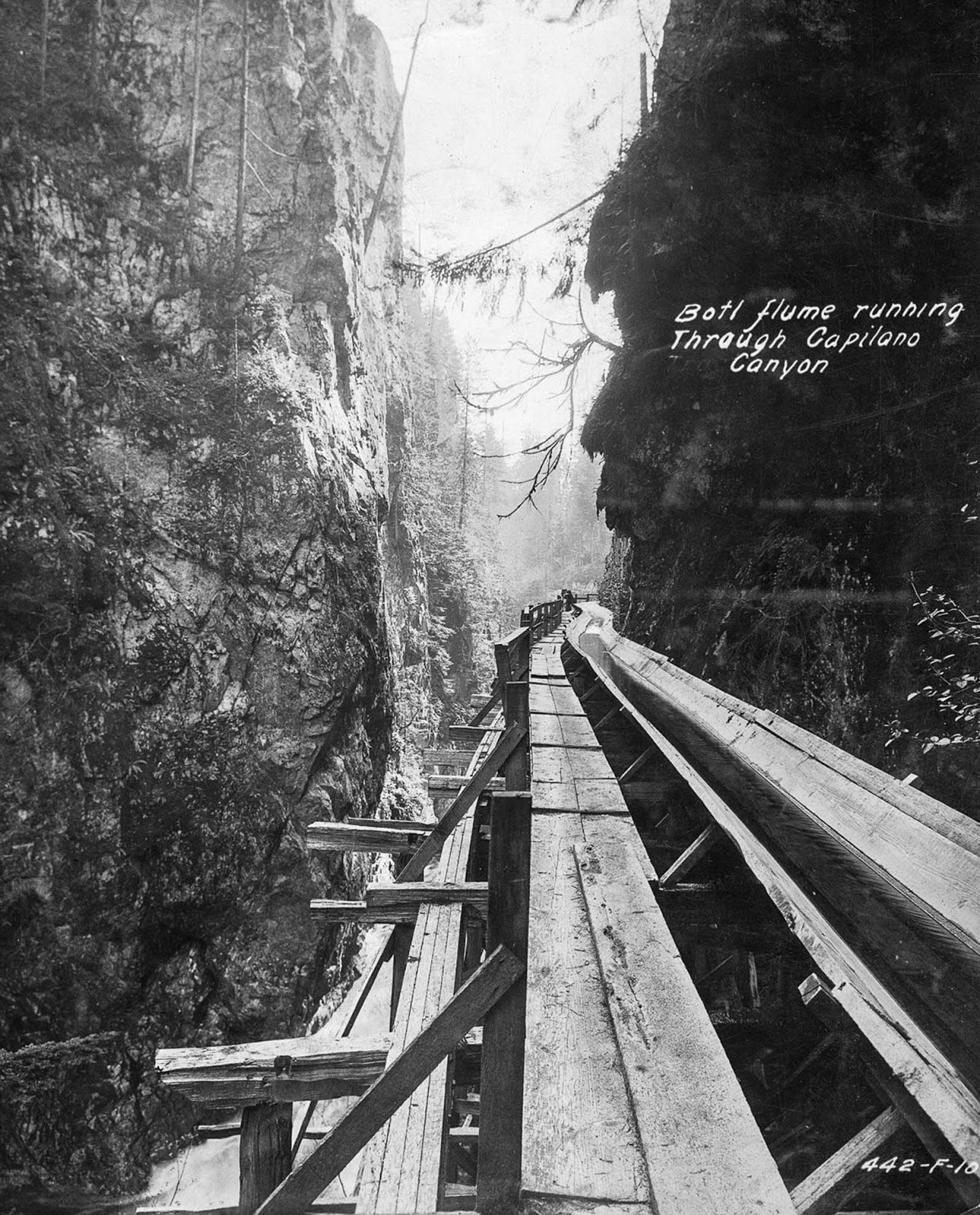 A log flume running through Capilano Canyon. 1919.