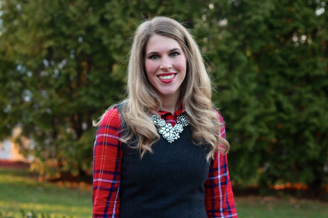 plaid button up under a grey sheath dress and tights
