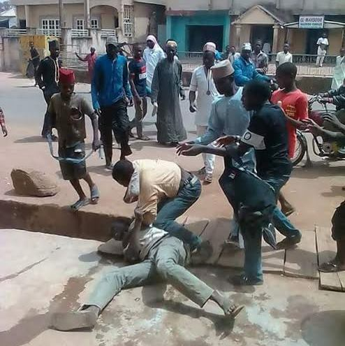 Photos: Mob attack man for abusing President Buhari
