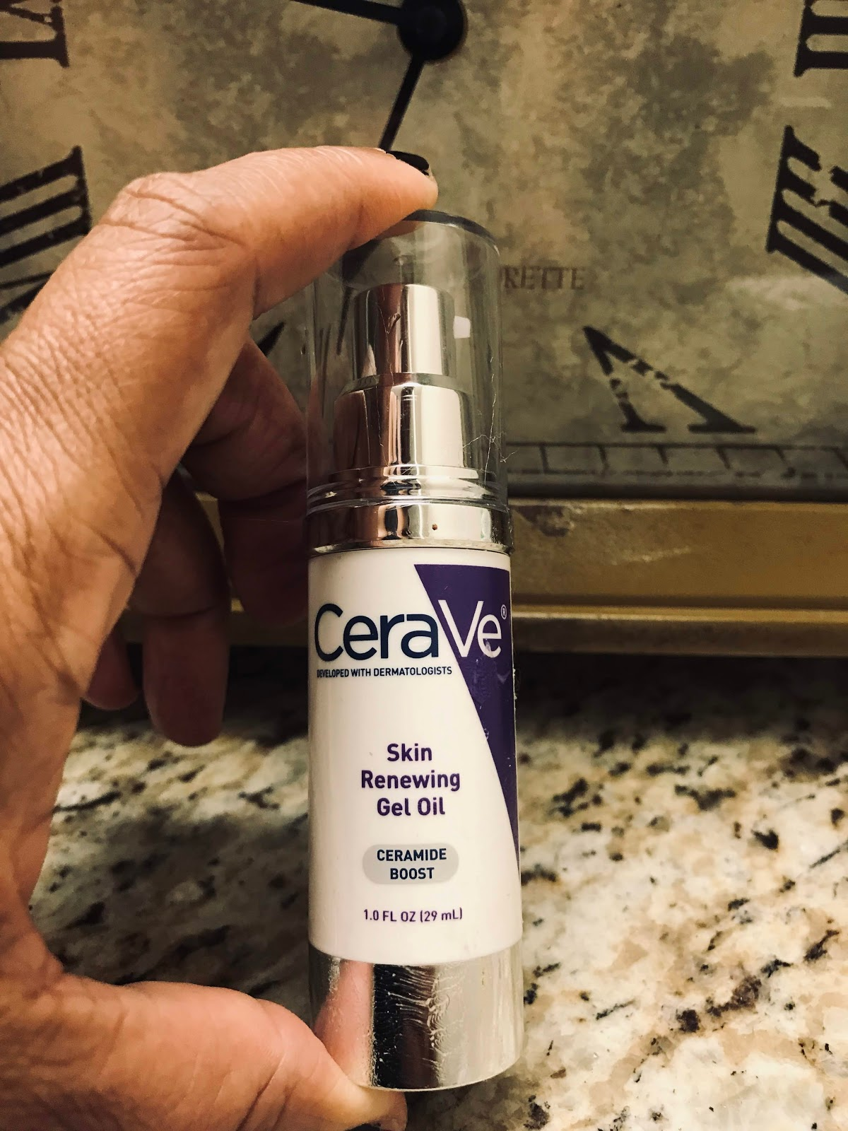 Image: Woman sharing her thoughts and reviews on the new Cerave skin renewing gel oil. Seen first on Bits and Babbles Blog.