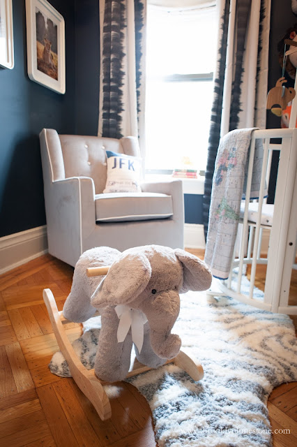Grey elephant in safari nursery with grey chair in background