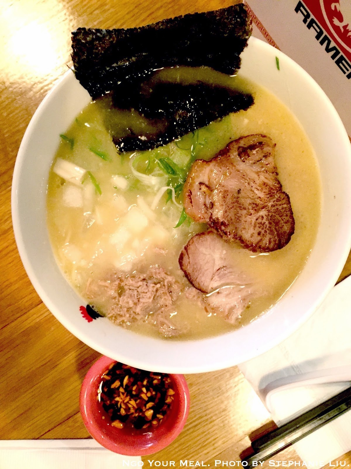 Paitan Ramen: These straight homemade noodles are cooked al dente style in a whole chicken and premium soy sauce based soup topped with scallion, onion and a nori at Totto Ramen.