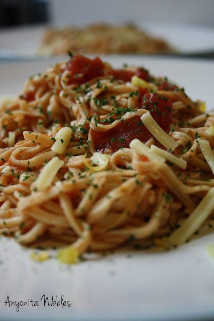 Two plates of homemade linguine with zesty tomato sauce
