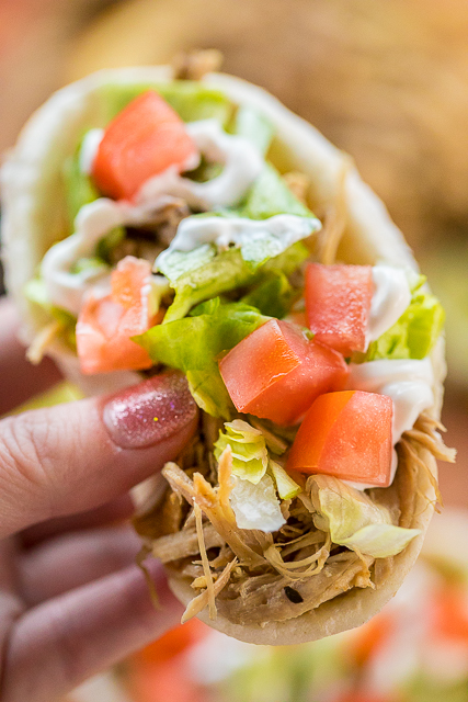 Slow Cooker MOJO Pork - pork shoulder slow cooked in garlic, cumin, oregano, orange juice and lime juice. SO good!!! Serve in tortillas or a bowl with rice, beans and your favorite taco toppings. Freeze the leftover pork for a quick meal later!! So much amazing flavor in this easy dinner! #slowcooker #pork #tacos