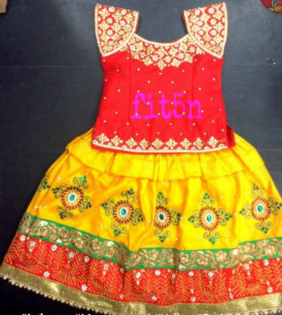 Yellow Lehenga with Red Kundan Blouse