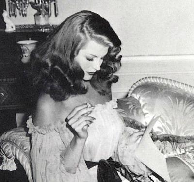 "Rita Hayworth checking the script between scenes of ""Gilda"""
