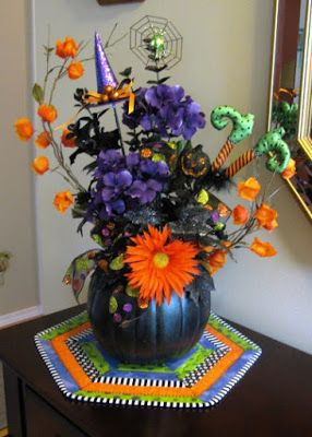 halloween floral arrangement with table topper