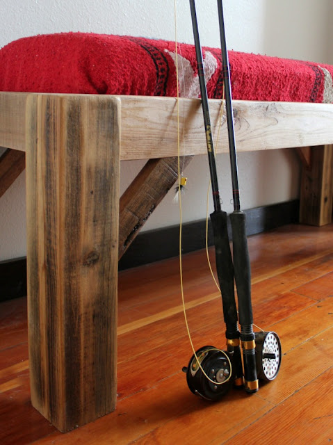 a rustic Montana bench made from reclaimed wood and a thrift store blanket