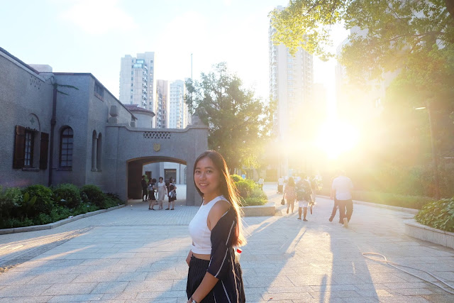 This is a photo about Columbia Circle in Shanghai when Sidney is wearing Double Stripes during summer from www.sidneyscarlett.com