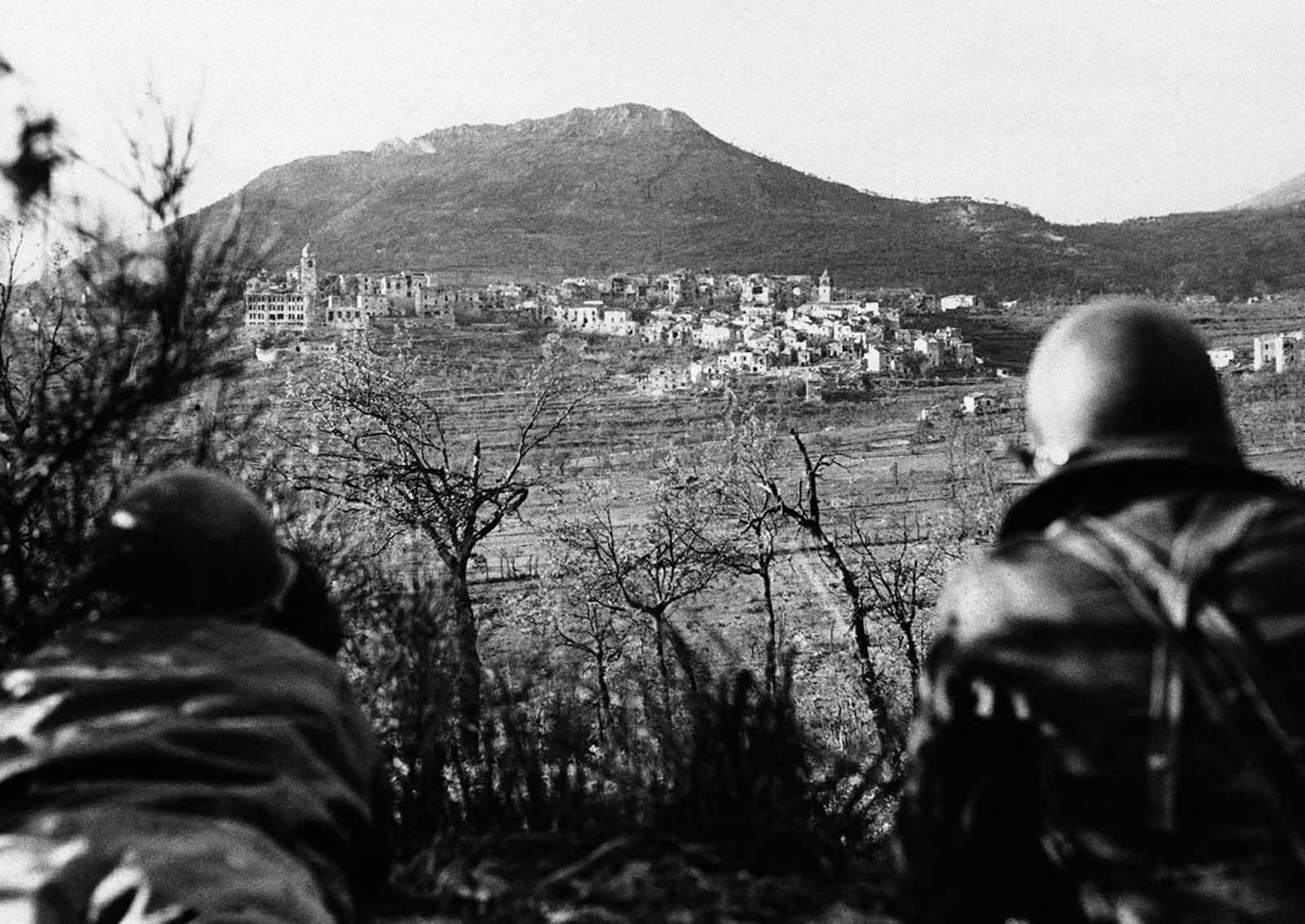 Artillery observers of the Fifth Army look over the German-held Italian town of San Vittore, on November 1, 1943, before an artillery barrage to dislodge the Germans.