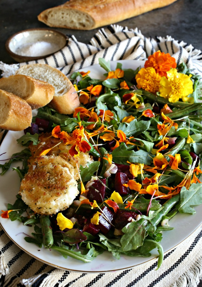 Salad with baby arugula, roasted beets, French green beans, edible flowers and fried goat cheese.