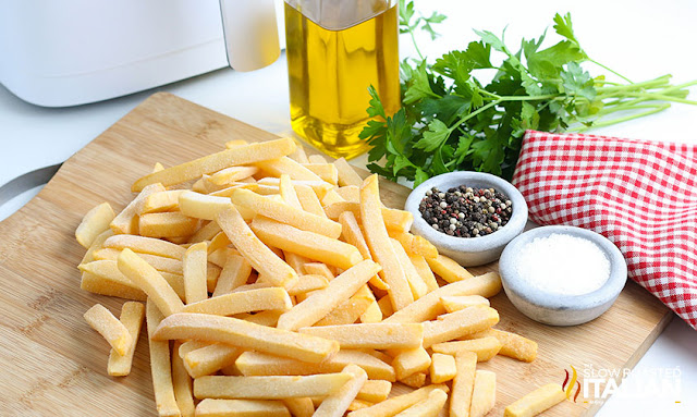 air fryer frozen french fries ingredietns on a cutting board
