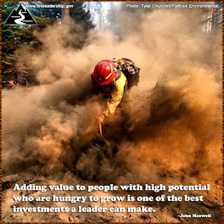 Adding value to people with high potential who are hungry to grow is one of the best investments a leader can make. - John Maxwell (Wildland firefighter throwing dirt)