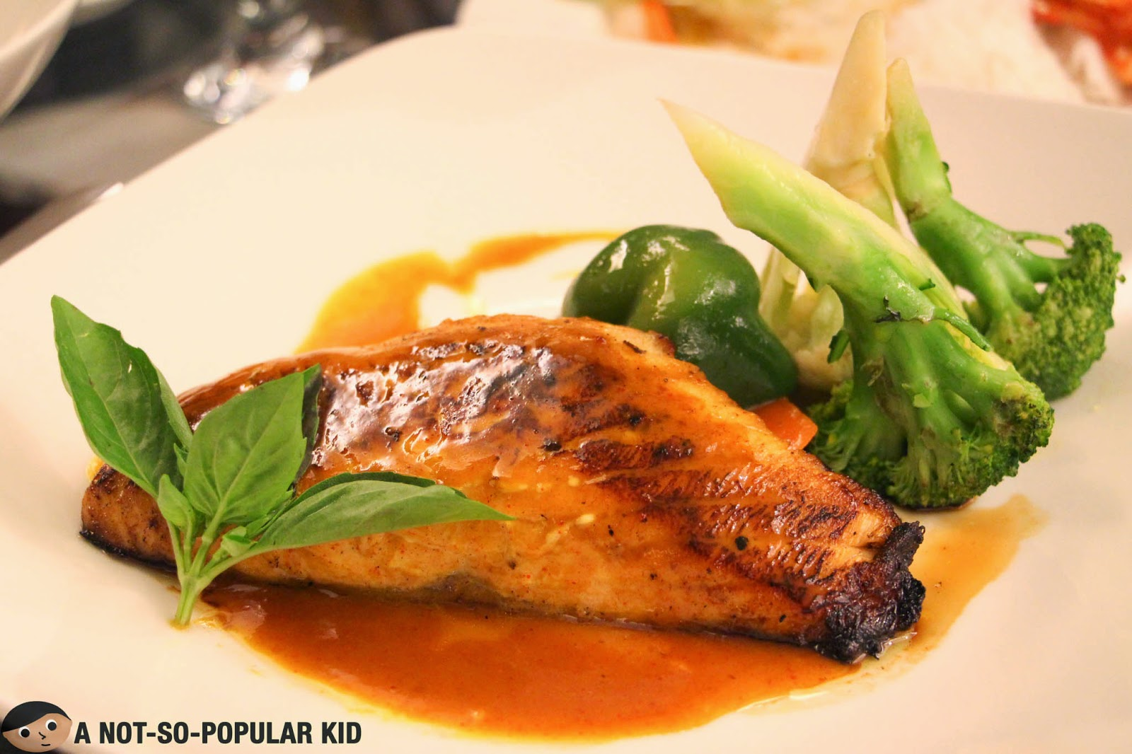 The surprisingly affordable Roasted Salmon of Cafe Astoria