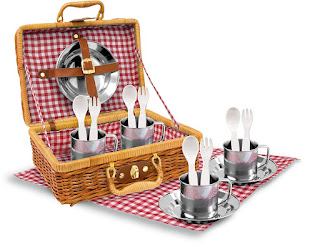 This stainless steel play picnic set with wicker basket contains four each of plates, cups, forks, spoons and one blanket to sit at.