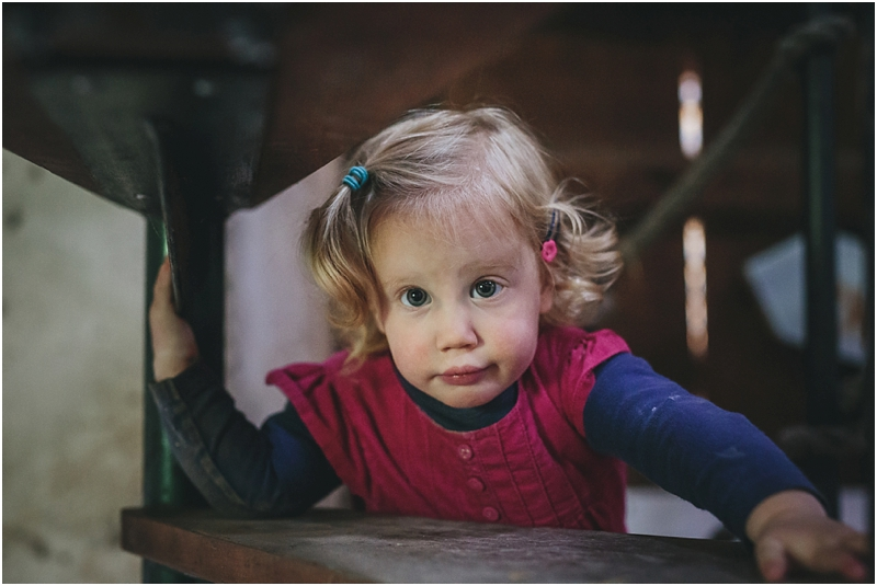 A young girl in a barn