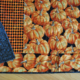Pumpkin Patch at Midnight spiderweb quilt hanging sleeve: QuiltBee
