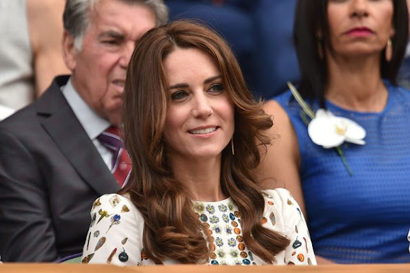 Duchess Catherine at the Men's Final of the Wimbledon. Kate Middleton wore Alexander McQueen Obsession Print Short Sleeve Dress. Brora Gold Charm Earrings, and carried her L.K. Bennett Natalie clutch.