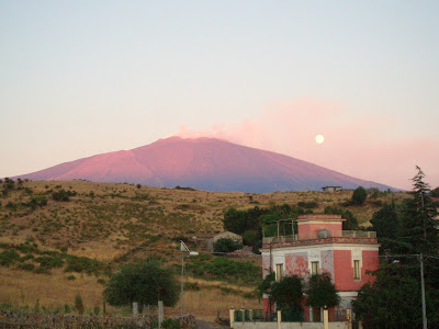 Mount Etna at sunset and the moon
