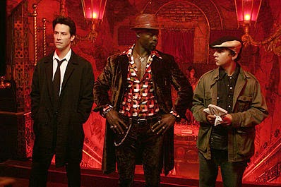 Djimon Hounsou as Midnite with Keanu Reeves and Shia LaBeouf as John Constantine and Chas Kramer in 2005 Constantine movie