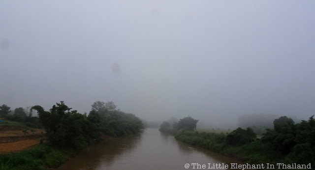 Crossing the Nan River at a foggy morning in Nan - Thailand