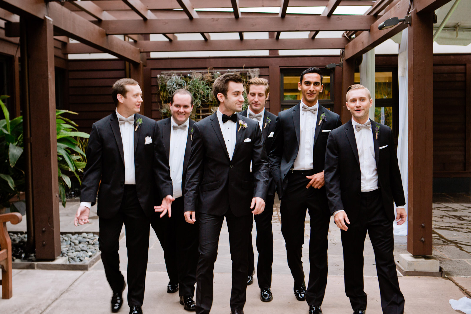 the groomsmen work on their cool walk