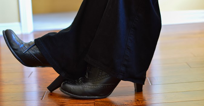 Black oxford high heel booties