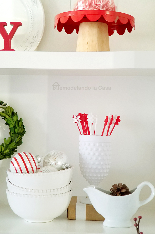 white bowls with dots, shelf styling