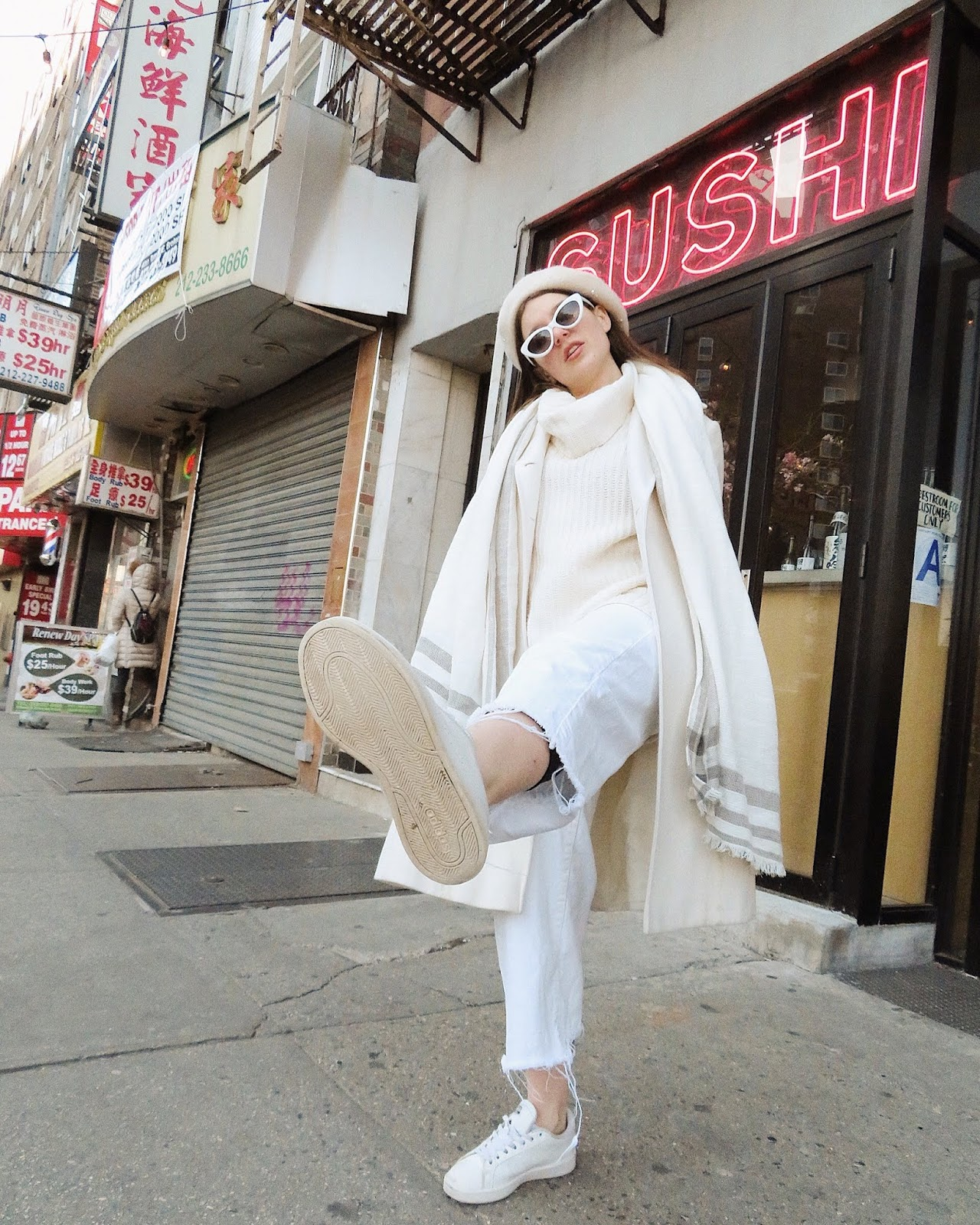 A girl posing in front of sushi shop in Chinatown, New York City