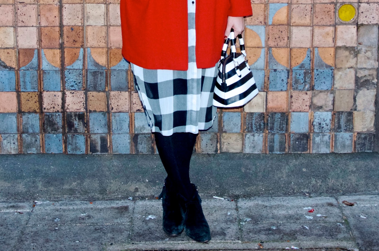 black and white striped bag, checkered dress, black tights and black suede boots